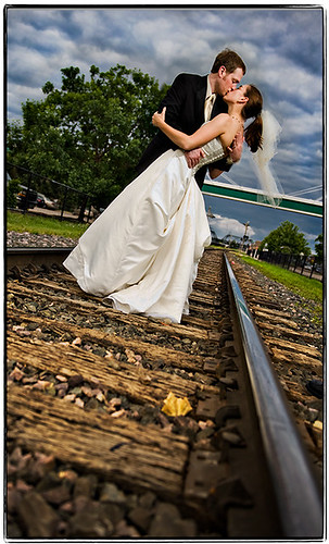 wedding storm love clouds groom bride leaf nikon kiss flash traintracks formal may iowa davenport 2008 d3 sb800 strobist dayaftersession chelseaandgarrett