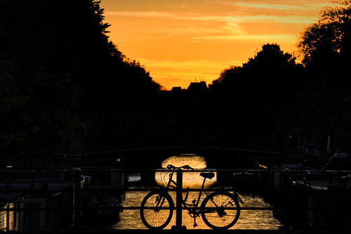bridge sunset orange water amsterdam bicycle silhouette yellow evening canal nightshot parking thenetherlands parked houseboats sundowner theperfectphotographer