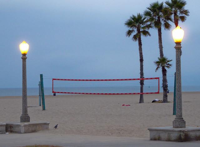 Volleyball net between lamp posts