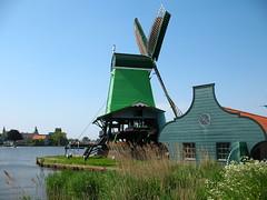 Bright green windmill in Zaanse Schans, the Netherlands