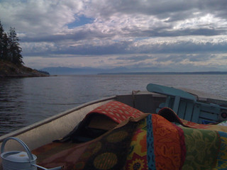 No road to Channel Rock on Cortes Island, BC, so I'm hauling luggage on dingy. Piloted it solo this time.   by ChristopherA