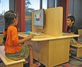 Children using computers. | by San José Public Library
