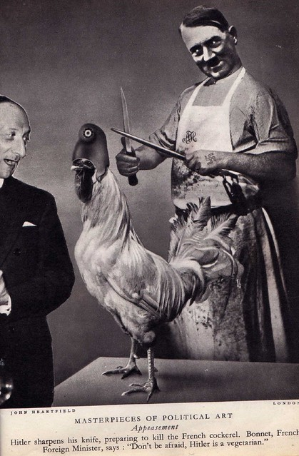 Hitler about to eat the French Cockerel.
