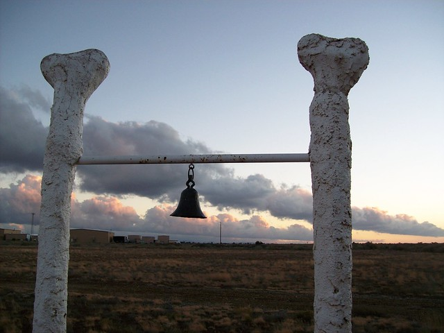 Bell outside the schoolhouse in the fading sunset at Bedrock City, Arizona - bedrock37x