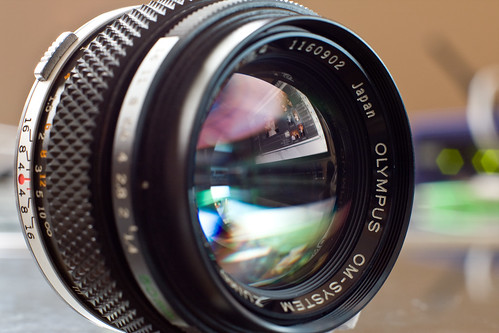 glass lens 50mm photo f14 olympus front om zuiko