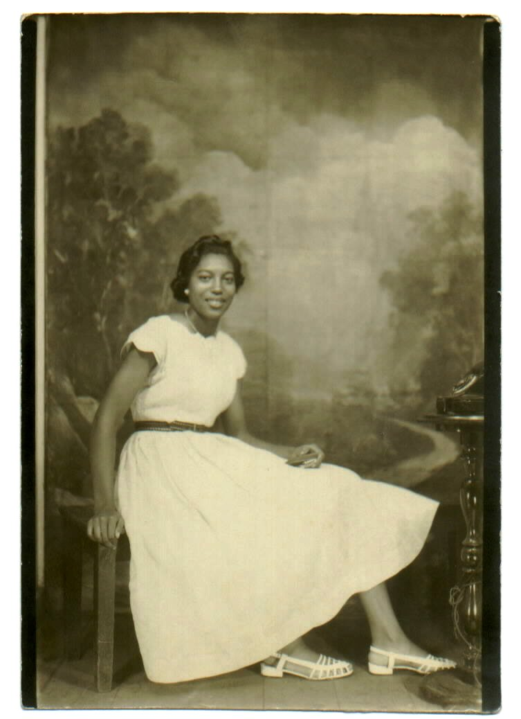 Woman In White Dress Photo Backdrop 1950s A Photo On