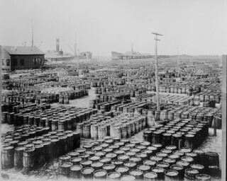 Hundreds of wooden barrels covering the docks at the resin yards