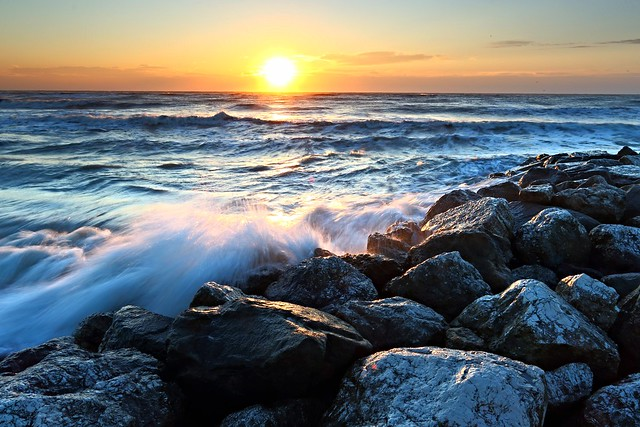 The rough sea at sunrise