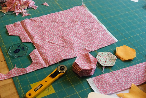 There is a fast way to cut out hexagons. That's on the bottom right-hand side. There's also a slower, more fabric-efficient way. That's on the left-hand side. I've opted for fabric efficiency. I drove four hours partly to access a quilt shop with these fabrics; I'll get the most out of them.