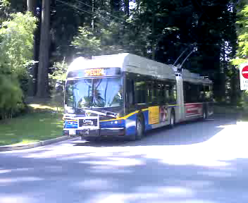 Articulated New Flyer trolley arrives at the Stanley Park loop