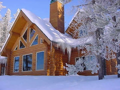 snow covered wooden home | by stan.stauffer