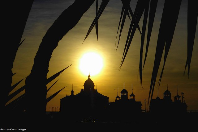 Silhouette of Eastbourne Pier against the morning sun