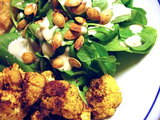 watercress with tahini dressing and pumpkin seeds; roasted golden cauliflower with sumac   by Tiny Banquet Committee