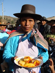 Woman serving us lunch at celebration in Huyuculano