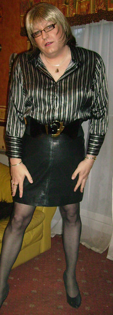 2b7756e604dee ... black leather skirt satin blouse standing