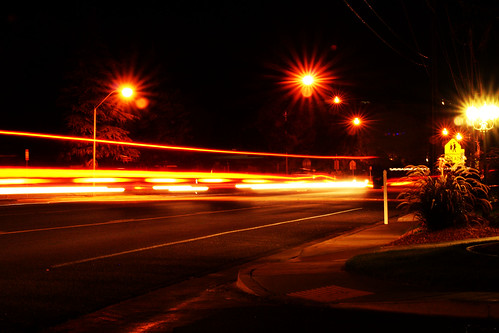 road street light red orange ahead sign yellow night lights utah long exposure desert crosswalk