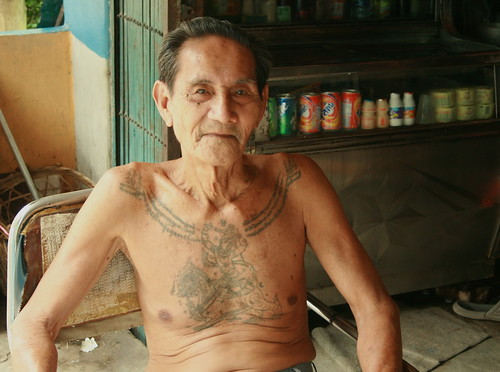 older man with protective tattoos