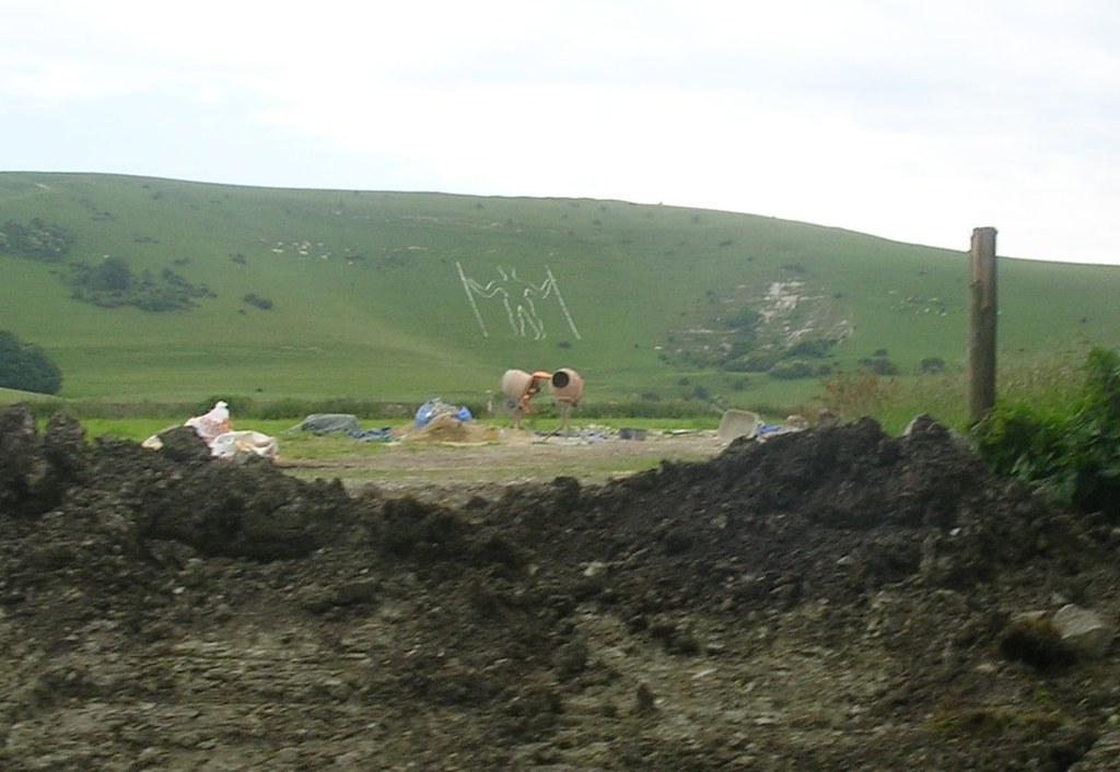 Long Man With ritualistic cement mixers Berwick to Eastbourne