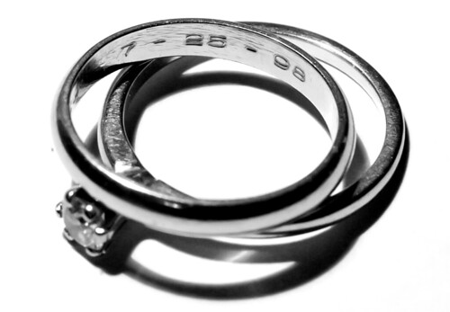 As on our bodies, so on our rings.  My wedding and engagement rings, ten years into the marriage.