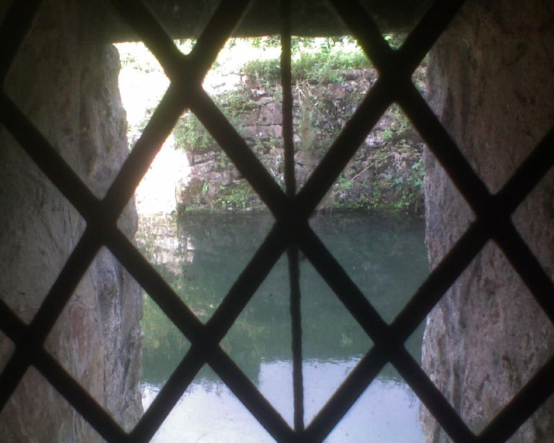 Looking out at the moat Inside Ightham Mote: Open Heritage Day Sevenoaks Circular