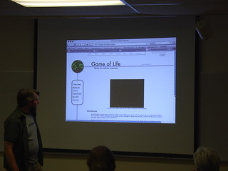 Andrew shows the group the Game of Life kit docs | by mightyohm