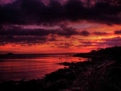 ocean blue sky orange sun water clouds sunrise gold rocks ships hdr