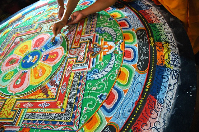 His Holiness Dagchen Rinpoche's hand holds a vajra drawing lines that close the Hevajra Mandala, after the empowerment, Tharlam Monastery of Tibetan Buddhism, Boudha, Kathmandu, Nepal