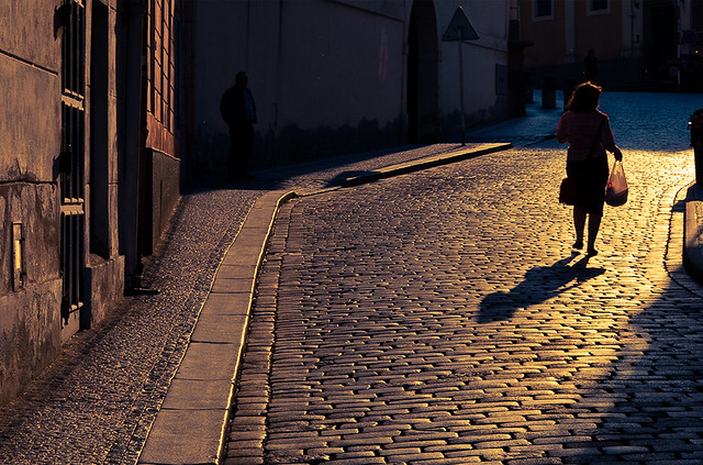 a shadow lurks in the darkness during a Prague sunrise