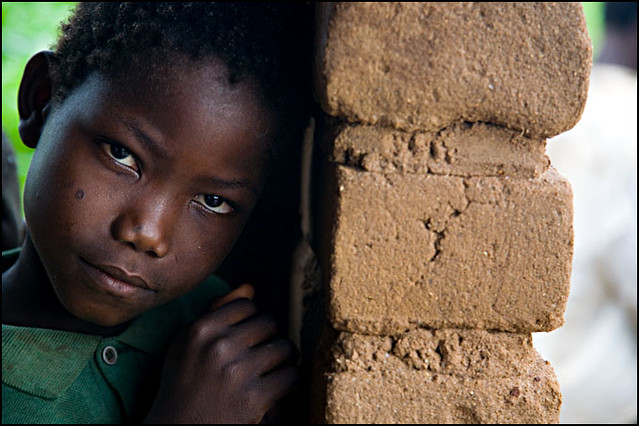 boy and brick wall - Malawi