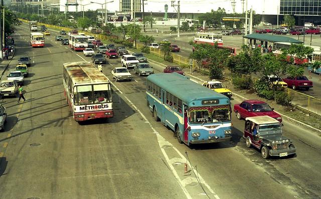 23991 (15) 20-10-1993 Metrobus NXL-153 and Metro Manila Transport Hino NVJ-359 (324) EDSA, Mandaluyong, Manila, Philippines.