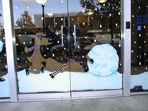 From Brad: 'This is a photo of the Christmas decoration applied last week to the front door of the Central Gas building downtown Victoria. Honestly! The artist—a naive young woman was merely depicting reindeer frolicking in the snow, helping each other push the giant snowball. Building management removed it within hours, but only after someone driving by complained! Across from City Hall, no less!'