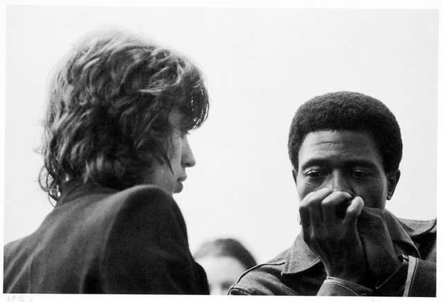 Junior Wells gives Mick Jagger a harmonica lesson. Berlin, Germany, October 1970