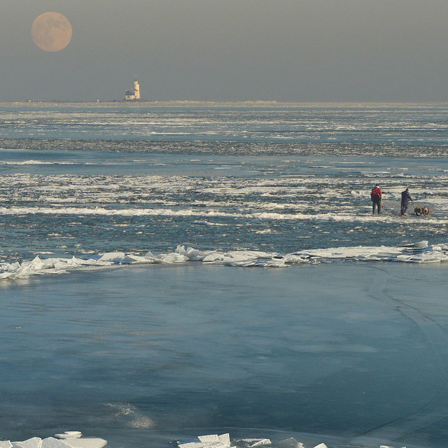 Dutch ice fishers watching the snow moon!