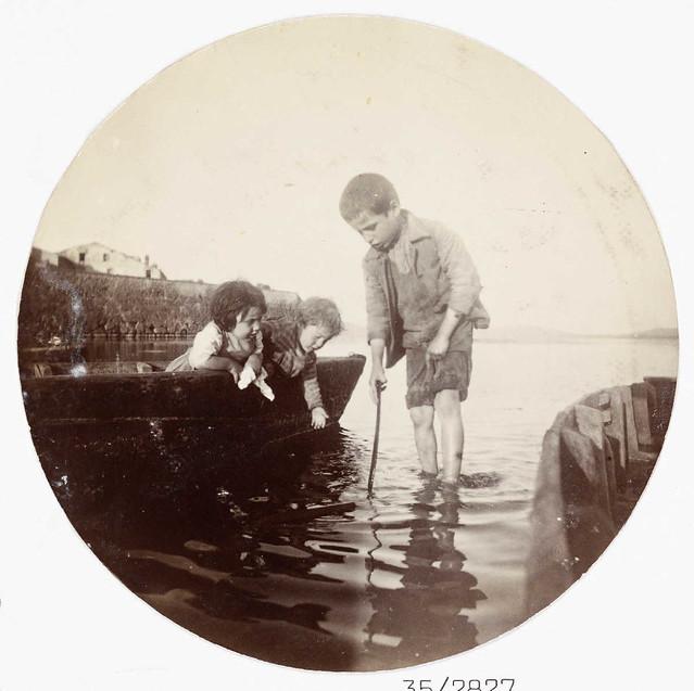 Boy paddling in the sea