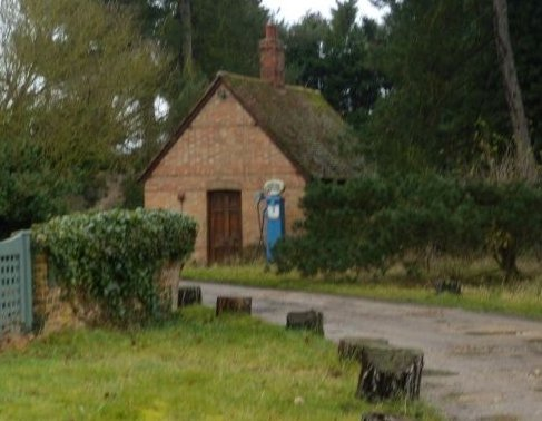 Old petrol pump And no-one standing in front of it. Kelvedon circular