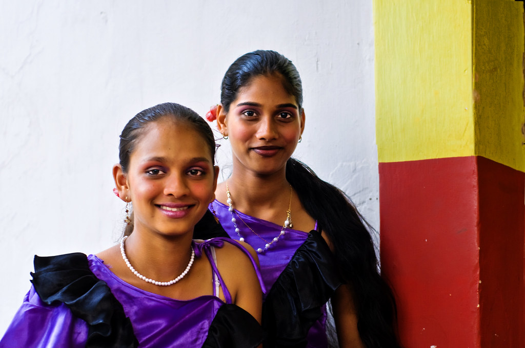 In Goa at Bonderam, Two Girls smile and wait for their turn to dance ! by Anoop Negi