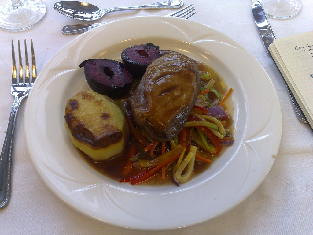 Spiced duck with plum, grilled vegetables and potato