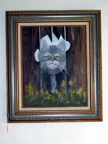 Freaky cat painting | Hanging above the bed at an estate ...