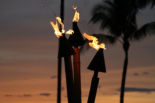 Tiki torches at sunset | by Kevin Briody