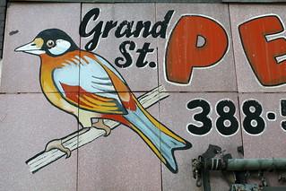 Logo of the former Grand Street Pet Shop, Williamsburg, Brooklyn