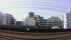 fisheye view from Narita Express Train leaving Tokyo