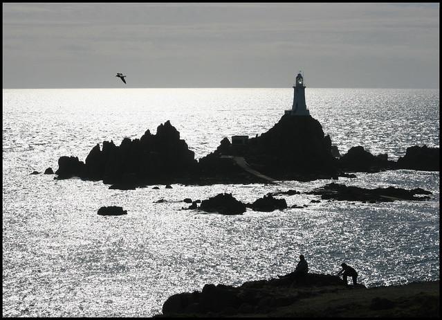 Silhouettes & Shimmering sea - La Corbiere Lighthouse, Jersey