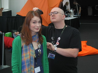 Felicia getting her hair brushed by Tycho of Penny Arcade