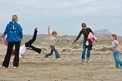Kids play skiprope on Morro Strand State Beach - Wholesome Family Scene