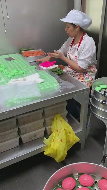 Older ladies making the Ang Ku Kueh