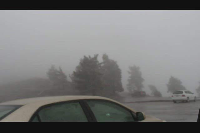 1405 Video of rain, sleet, and snow at Inspiration Point from the door on the leeward side of the car