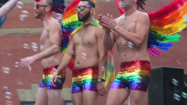 Joy and Beautiful Faces from the Calgary Pride Parade - A bit of beefcake doesn't hurt every once in a while...