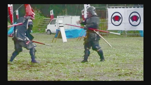 Samurai loses helmet tip to a head strike