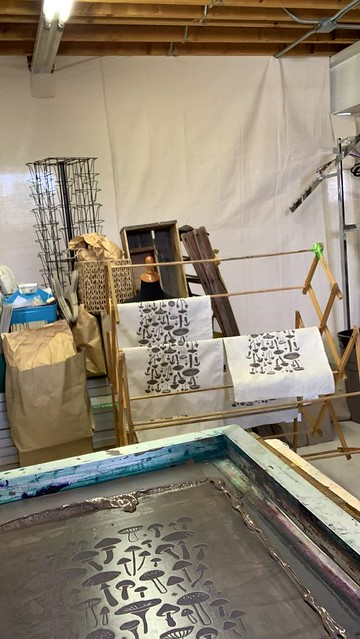 Eliza in the studio - printing mushroom pattern on new linen tea towels