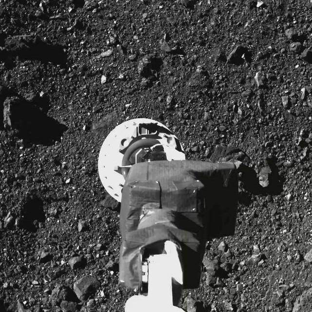 OSIRIS-REx TAGs Surface of Asteroid Bennu